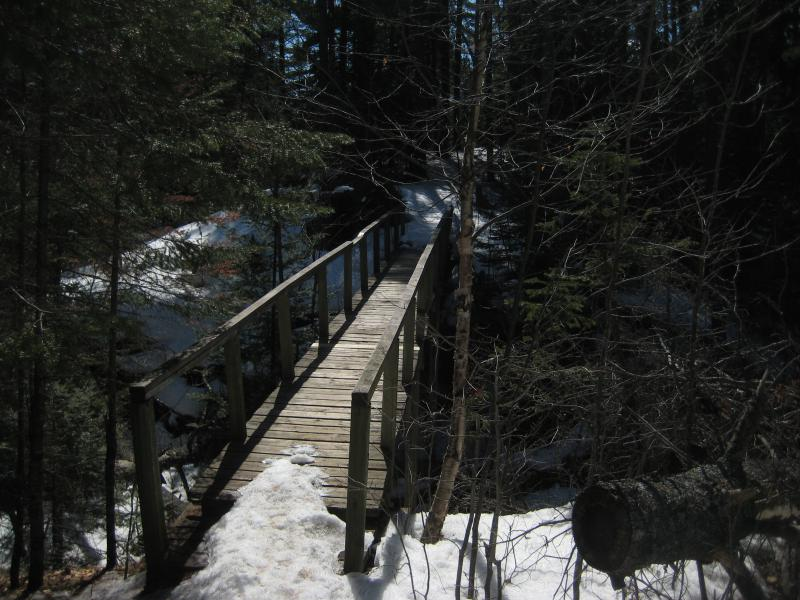 The first wooden bridge over a rocky gap