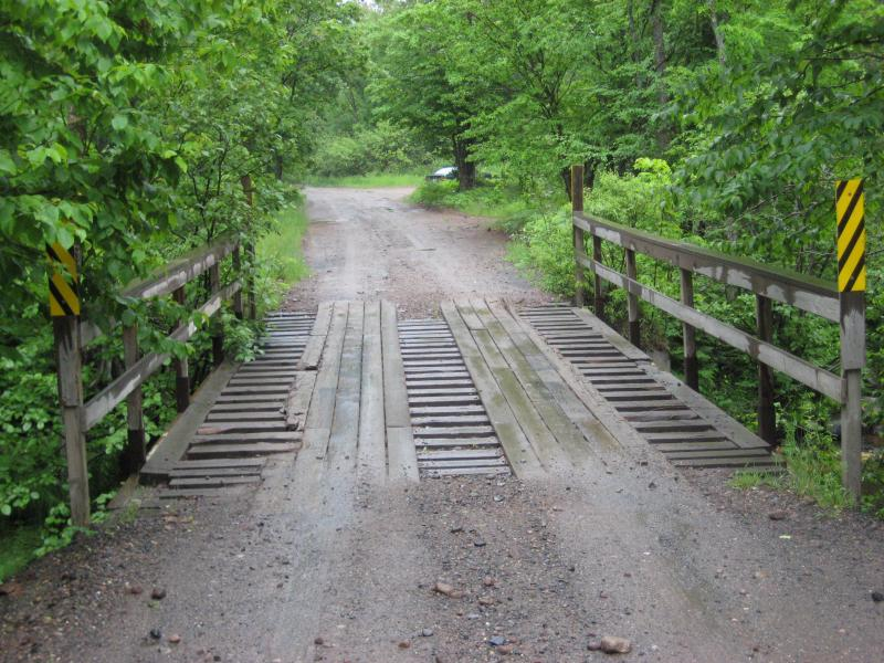 Wet wooden bridge over the river