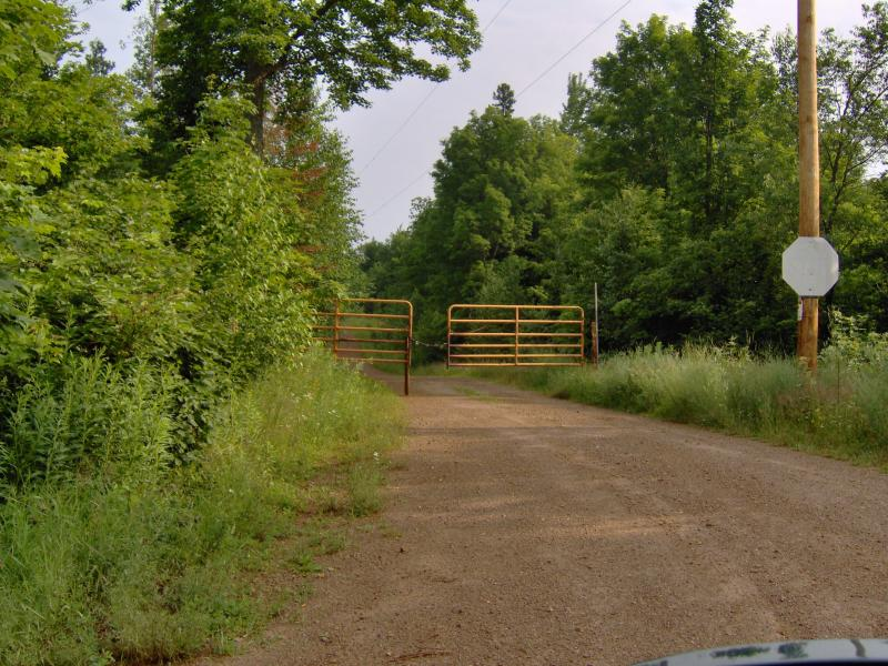 Angry orange gate near Michigamme