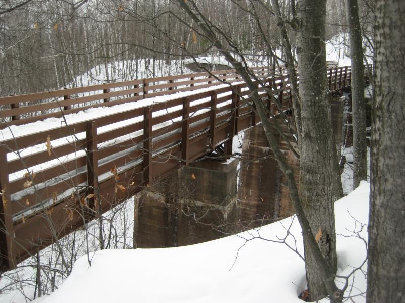 Wooden bridge over the old trestle