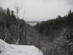 Snowy valley reaching to Torch Lake