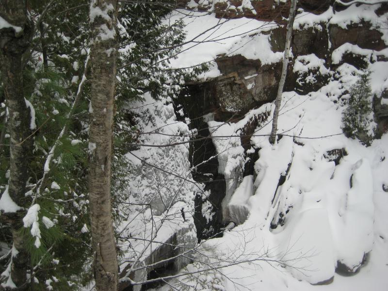 Snow covered walls of ice and rock