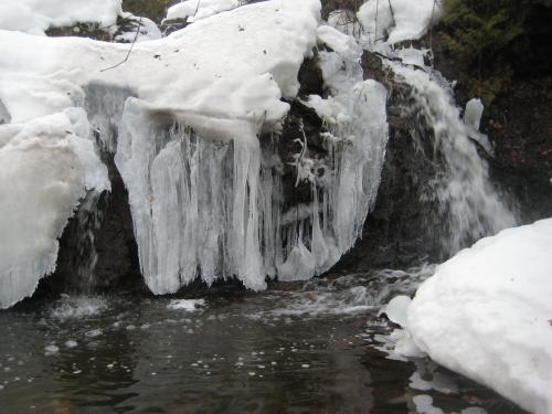 Icicles hanging off the rocks near the falls