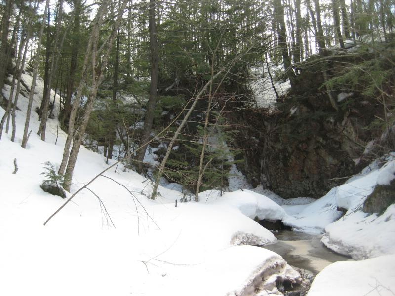 Looking up the steep rock wall