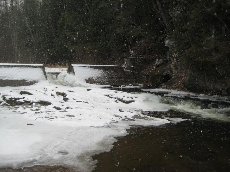 Water funneling through snowy dam