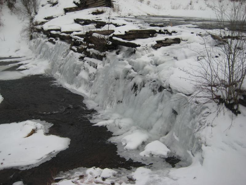 Ice coating the timber crib dam