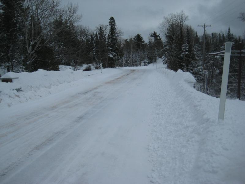 Deep snow pushed off the road