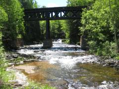 The falls beyond the older railroad bridge