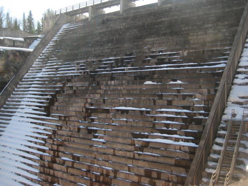Steps reaching up the tall dam